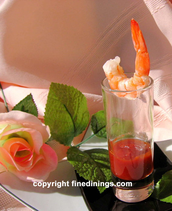 Amuse Bouche Shrimp with cocktail sauce in a shot glass